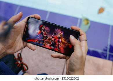 Jakarta, Indonesia - February 14, 2019: The man playing a Contra Returns on Asus ROG Phone gaming smartphone.