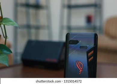 Jakarta, Indonesia - February 17, 2019: The ASUS ROG Phone gaming smartphone has a ROG logo on the back.