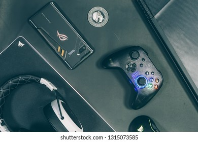 Jakarta, Indonesia - February 17, 2019: The back of Asus ROG Phone gaming smartphone with GameSir T4 controller, headphone and mouse.