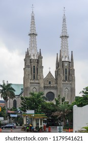 """Jakarta, Indonesia - February 2 2015: Exterior view of the Jakarta Cathedral """"De Kerk van Onze Lieve Vrowe ten Hemelopneming - The Church of Our Lady of the Assumption"""" ."""