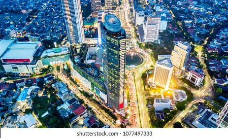 Jakarta, Indonesia. February 22, 2018: Top view of the Welcome Monument and Bank Central Asia building in Central Jakarta at night. Jakarta is the capital city of Indonesia