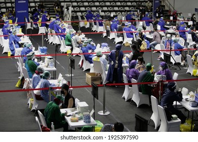 Jakarta, Indonesia.  February 26, 2021.   Peoples prepare to get a shot of the anti-Covid-19 vaccine. This mass vaccine event is open for the media people