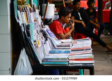 JAKARTA, INDONESIA - February 3, 2016: A magazine seller at Jalan Sabang (Sabang Street) in Central Jakarta, Indonesia.