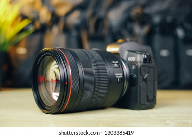 Jakarta, Indonesia - February 4, 2019: Side part of Canon EOS R full frame mirrorless camera with RF 24-105mm f/4L USM lens.