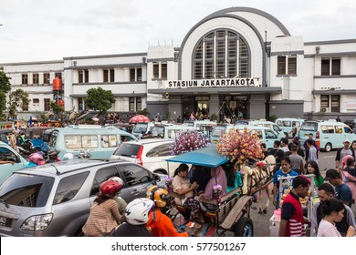 JAKARTA, INDONESIA - FEBRUARY 5, 2017: Heavy traffic, including a decorated horse cart, stuck in traffic jam in front of Jakartakota train station in north Jakarta in Indonesia capital city.
