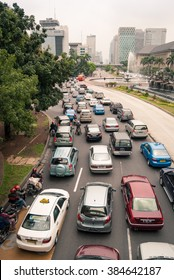 JAKARTA, INDONESIA - FEBRUARY 6, 2010: A traffic jam on a busy street in the Jakarta city centre.