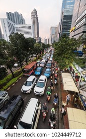 Jakarta, Indonesia - February 9 2018: Cars, buses and motorcycles stuck in a traffic jam on Sudirman street in Jakarta business district in Indonesia capital city.