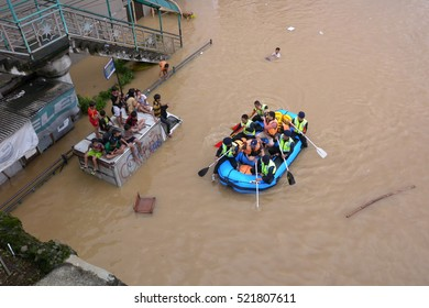 Jakarta, Indonesia - January 18, 2014: Rescue officers on patrol to evacuate flood victims in Jakarta - Indonesia