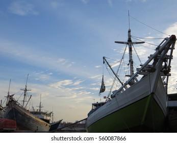 JAKARTA, INDONESIA - January 18, 2017: Indonesian traditional schooners Phinisi docking in Sunda Kelapa Harbor
