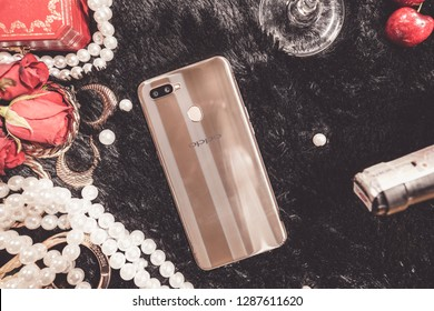 Jakarta, Indonesia - January 18, 2019:  The back of OPPO A7 Android smartphone in dazzling gold colour.