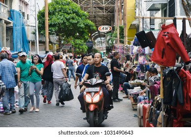 Jakarta, Indonesia, January 1st 2018 : The daily atmosphere of a traditional market in Jakarta, named Pasar Baru (New Market). People like to walk and shop there.