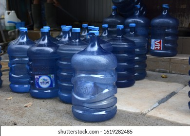 Jakarta, Indonesia - January 2020: Many containers of water are waiting to be filled with drinking water refills in the place of business turning raw water into ready-to-drink water.