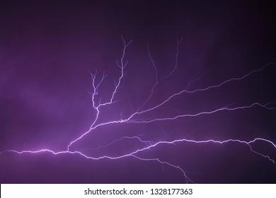 Jakarta, Indonesia - January 24, 2019 : Purple sky with Thunderstorm