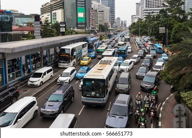 JAKARTA, INDONESIA - JANUARY 27, 2017: Cars, buses and motorcycles try to move in a traffic jam in the business district of Jakarta. The Indonesia capital city is famous for its congestion problems.