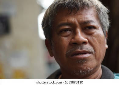 Jakarta, Indonesia, January 30 2015 : An expression from a senior asian man with blurred background.
