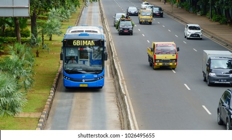 JAKARTA, INDONESIA - JANUARY 9 2018: Transjakarta bus drove on a special lane in downtown Jakarta.