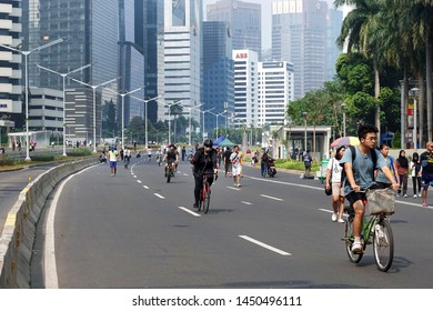 Jakarta, Indonesia July 14, 2019: people are walking and cycling during car free day on Sudirman street every sunday morning.