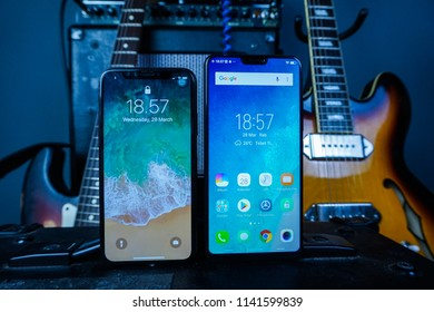 Jakarta, Indonesia - July 25, 2018: The Apple iPhone X vs Vivo V9 comparison smartphone.
