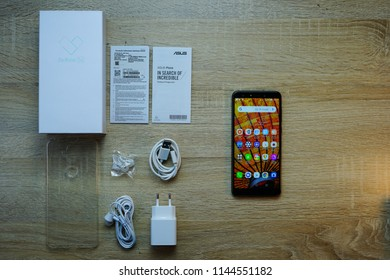 Jakarta, Indonesia - July 29, 2018: Unboxing the Asus Zenfone 5Q smartphone, also known as Asus Zenfone 5 Lite.