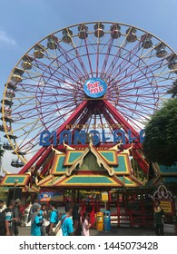 Jakarta, Indonesia - July 6, 2019: Ferris Wheel game at Fantasy World theme park. Photographed during queue  in line among the visitors to get in the Ferris Wheel.