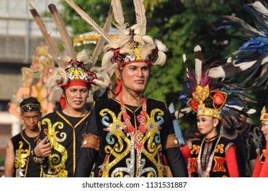 Jakarta, Indonesia - July 8, 2018: Dayak people with traditional costume participated in Jakarta Carnival parade, Jakarta, Indonesia