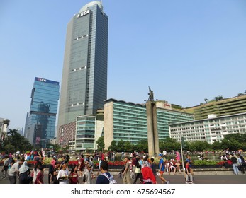 JAKARTA, INDONESIA - July 9, 2017: Crowd of people doing activities on Hotel Indonesia Roundabout (Bundaran HI) on Sunday morning (car free day).