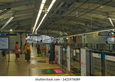 Jakarta, Indonesia - june 06 2019: crowded passenger on the MRT station and inside the MRT train during eid al fitr.
