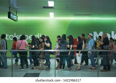 Jakarta, Indonesia - June 06 2019: queueing people when entering MRT station.