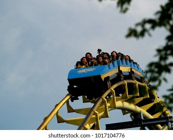 Jakarta, Indonesia - June 1, 2008: People enjoying riding a roller coaster in Dufan Ancol