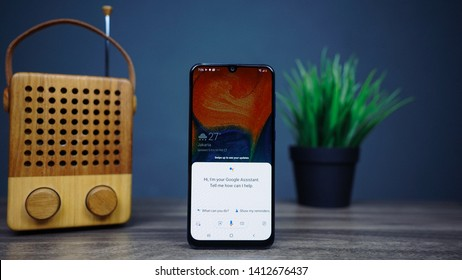 Jakarta, Indonesia - June 1, 2019: Use Google Assistant on Samsung Galaxy A30 Android smartphone, get help anytime, anywhere.