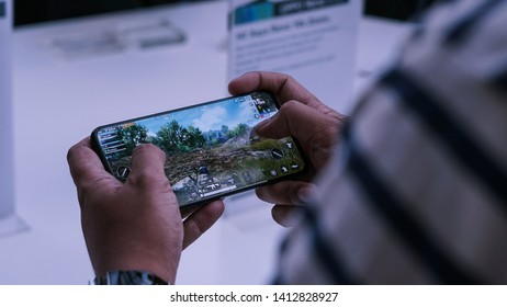 Jakarta, Indonesia - June 1, 2019: The OPPO Reno 10x Zoom flagship Android smartphone playing a PUBG Mobile games.