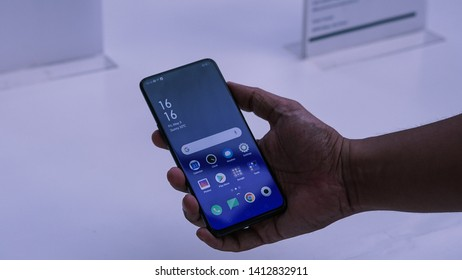 """Jakarta, Indonesia - June 1, 2019: The Oppo Reno 10x zoom features a notch-less 6.6"""" OLED screen with unique shark fin pop-up 16MP selfie cam."""