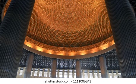 Jakarta, Indonesia - June 11, 2018: The interior of the main dome of istiqlal Mosque.
