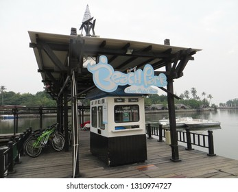 Jakarta, Indonesia - June 12, 2018: A ticket booth of pedal boat and bicycle rental on Ancol Beach.