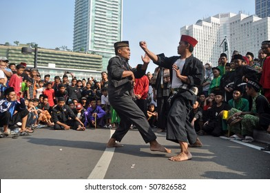 Jakarta, Indonesia - June 14, 2015 : Pencak Silat Betawi warriors enliven the Performance of 1000 Warrior in the area of Bundaran Hotel Indonesia, Jakarta, Indonesia,