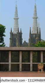 Jakarta, Indonesia - June 14, 2017: Jakarta Cathedral or Gereja Katedral seen from Istiqlal Mosque.