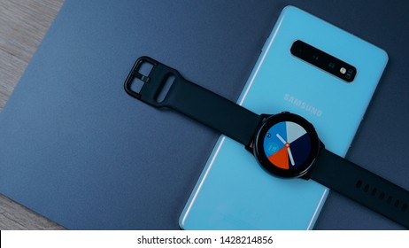 Jakarta, Indonesia - June 19, 2019: Meet the next generation Samsung Galaxy Watch Active, with Samsung Galaxy S10+ flagship Android smartphone.