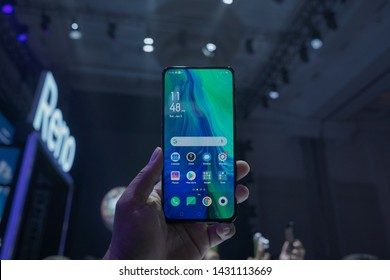 """Jakarta, Indonesia - June 22, 2019: The Oppo Reno 10x zoom features a notch-less 6.6"""" OLED screen with unique shark fin pop-up 16MP selfie cam."""