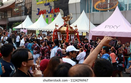 Jakarta, Indonesia - June 30, 2018: Crowd of people see parade of Mikoshi (divine palanquin or portable Shinto shrine) in Ennichisai Blok M (Japanese Festival) in South Jakarta.