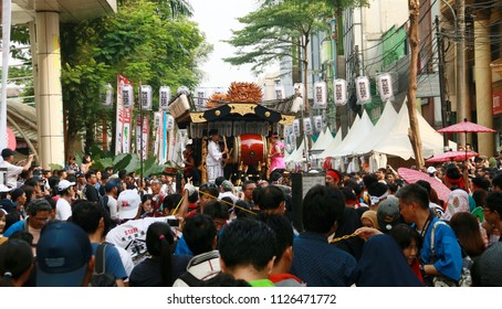 Jakarta, Indonesia - June 30, 2018: Crowd of people see parade of Dashi (colorfully decorated floats) in Ennichisai Blok M (Japanese Festival) in South Jakarta.