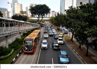 Jakarta, Indonesia - June 4, 2015: Transjakarta bus was passing in a special way in Sudirman street, Jakarta, Indonesia
