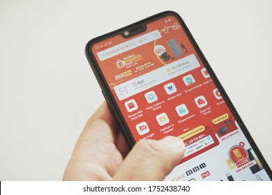 Jakarta, indonesia - June 7 2020: Close up of a hand holding a smartphone while opening shopee app. Smartphone opening shopee e commerce.