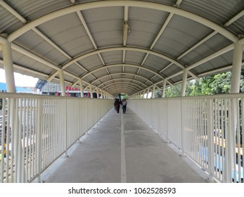 JAKARTA, INDONESIA - June 8, 2017: Pedestrian bridge connecting to Palmerah Station and TransJakarta bus shelter.