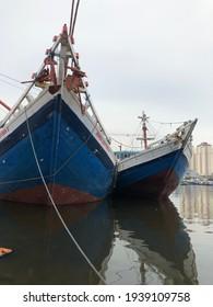 Jakarta, Indonesia - March 15, 2021: Indonesian traditional phinisi docking in old port Sunda Kelapa Jakarta, Indonesia