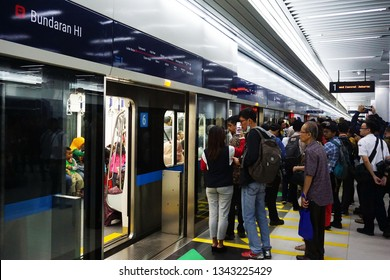 Jakarta, Indonesia March 19,2019: MRT passengers queue to board the train at Bundaran HI station.The Jakarta MRT start operations  in March 2019 from Bundaran HI  to Lebak Bulus in distance of 16 km.