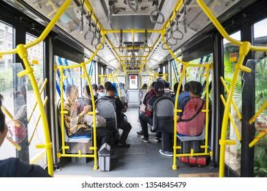 JAKARTA - Indonesia. March 20, 2019: Interior of Transjakarta bus with passengers