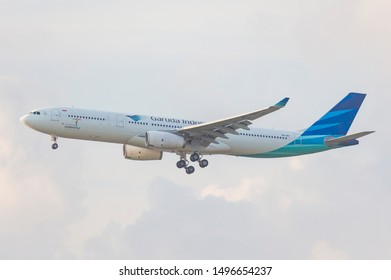 JAKARTA, INDONESIA - MARCH 20, 2019 : A Garuda Indonesia Airbus A330-300 arriving at Soekarno Hatta Intl Airport in Jakarta, Indonesia.
