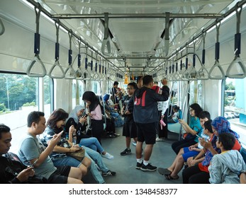 Jakarta, Indonesia - March 23, 2019: Passengers on the train of MRT Jakarta at Lebak Bulus MRT Station.