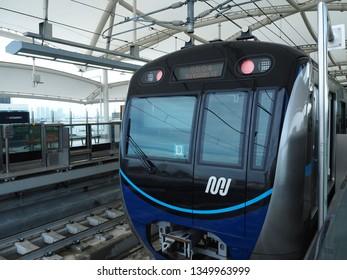 Jakarta, Indonesia - March 23, 2019: MRT Jakarta train arrives at Fatmawati MRT Station.