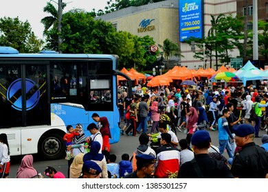 Jakarta, Indonesia - March 23, 2019: Transjakarta is among the people who are enjoying car-free days in Thamrin, Jakarta. On Sundays this area is free of vehicles, for people to exercise.
